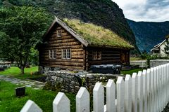 Old wood house with grass roof stock photo