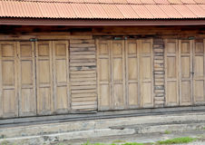 Old wood house thai. Old wooden building long wooden fifties. Sixty years through the use of a wooden house, a wooden classic that is a must conserve. In Chiang Royalty Free Stock Photos