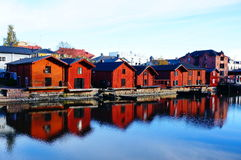 Old wood houses and reflection in water. View of old wood houses and reflection in water,  Porvoo Finland Stock Photo