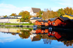 Old wood houses and reflection in water Stock Image