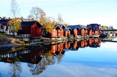 Old wood houses and reflection in water. View of old wood houses and reflection in water,  Porvoo Finland Royalty Free Stock Image