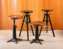 Old wood and iron revolving stools Stock Images