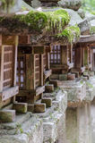 Old wood lanterns. Traditional japanese wood and stone lanterns Royalty Free Stock Photos