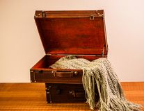 Old Wood and Leather Suitcases with Throw Royalty Free Stock Photography