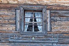 Old wood  mountain cabin hut window Royalty Free Stock Photo