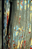 A barn painting many times. Old  wood with old paint different colors peeling off Stock Photo