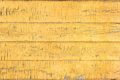 Old wood painted board yellow fence texture Royalty Free Stock Image