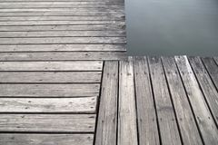 Grey wood pier by the lake background Stock Photo