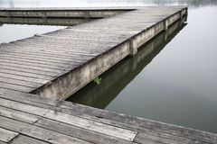 Old grey wood pier by the lake stock photos