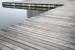 Old grey wood pier by the lake background Stock Photography