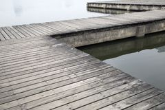 Old wood pier by the river royalty free stock photos