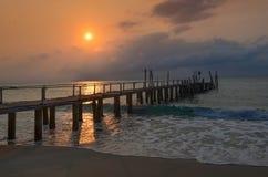 Old wood pier, sunset Stock Photos