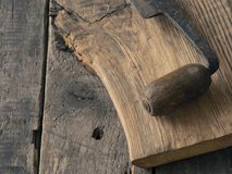 Old wood plane on oak plank. Old wood plane on a rustic oak plank, wood working or carpentry background, vintage color stylized Stock Photo