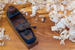 Wood Plane on slab with Wood Shavings Stock Photo
