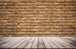 Old wood plank with abstract old brick wall background. For product display stock photo