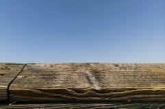 Old wood plank on a blue sky. stock photos