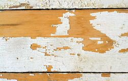 Old wood plank with cracked paint. Old wood plank with cracked white paint texture background Royalty Free Stock Image