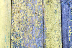 Old wood plank. Gloomy wooden rustic background, peeling old yellow paint Stock Photo