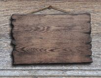 Old wood plank or plate hanging on timber plank Stock Photo