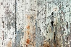 Old wood planks background. Old wood  planks with white peeling paint background Royalty Free Stock Image