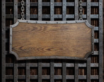 Old wood plate or sign on chain Stock Photos