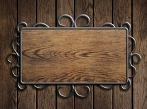 Old wood plate or sign in metal frame on vintage Royalty Free Stock Photos