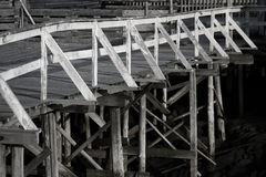 Old wood pontoon. Section of an old wood pontoon at Henningsvear in Norway, taken in black and white Royalty Free Stock Image