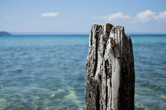 Old wood post with sea background Royalty Free Stock Image