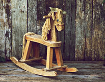 Old wood rocking horse on wood. Stock Photos