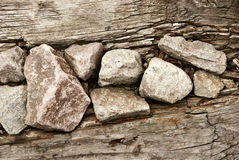 Old wood and rocks background Stock Image