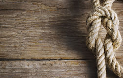 Old wood with rope knot. Old wood with a rope knot Stock Photo