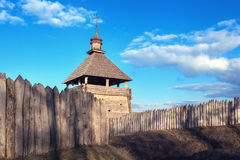 Old wood rustic church building and wooden fence against blue sk Royalty Free Stock Photos