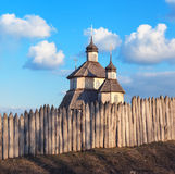 Old wood rustic church building and wooden fence against blue sk Royalty Free Stock Photo
