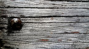 Old wood with rusty nail