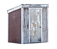 Old Wood Shed or Outhouse. An Old, dilapidated wood shed or outhouse with paint peeling off. Isolated on a white background Royalty Free Stock Photography