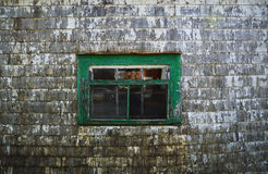 Old wood shed siding and window with peeling white paint backgro Stock Images