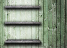 Old wood shelf. On wooden wall royalty free stock photo