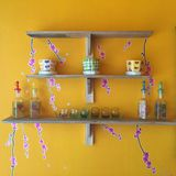 Old wood shelf on retro wall. Yellow wall with wood shelf with glass and stock photography