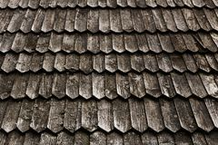 Old wood shingle roof with rough surface. Old grey weathered wood shingle roof with rough surface background Stock Photos