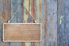 Old wood sign board. On vintage wall Stock Photography