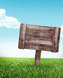 Old wood sign in the meadow. Old wood sign on the meadow, sample your text Stock Photos