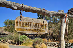 Old wood signboard with arrow and text `bright future ` Royalty Free Stock Photo