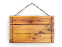 Old wood signboard on chain. Royalty Free Stock Photo