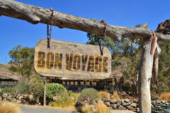 Old wood signboard with text ` bon voyage`. Hanging on a branch Royalty Free Stock Image