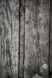 Old wood. A small detail of a gray wooden door from a downtown building Royalty Free Stock Photography