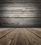Old Wood Stage Background. With vertical natural distressed antique wooden plank floor and horizontal weathered wall as an aged grunge back drop  with copy Royalty Free Stock Images
