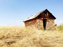 Old wood and stone structure in Montana. Old western abandoned structure in field in Montana Stock Image