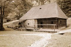 Old wood and stone watermill Royalty Free Stock Photo