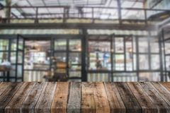 Old wood table with blur cafe backgorund Royalty Free Stock Image