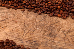 Old wood table with coffe beans Royalty Free Stock Photography